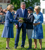Rosalind Canter receiving the Butler Bowl for best British rider, at the 2017 Mitsubishi Motors Horse Trials with the Duchess of Beaufort, Lance Bradley and the Duchess of Cornwall