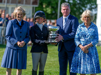 Rosalind Canter receiving the Laurence Rook Trophy for best British rider not to have previously completed Badminton, with the Duchess of Beaufort, Lance Bradley and the Duchess of Cornwall